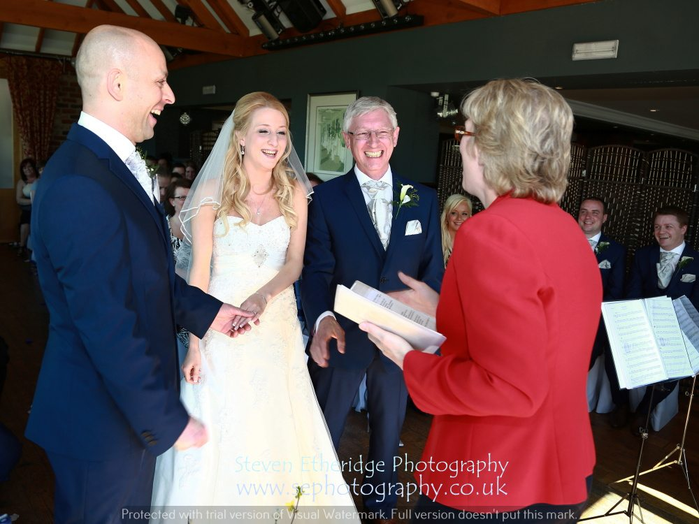 Hampshire Wedding Photography - the bride's father giving his daughter away