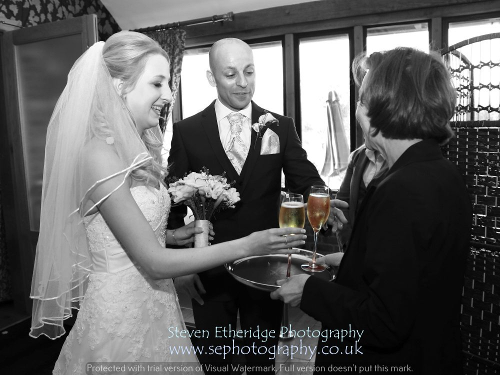 Hampshire Wedding Photography - bride and groom with champagne