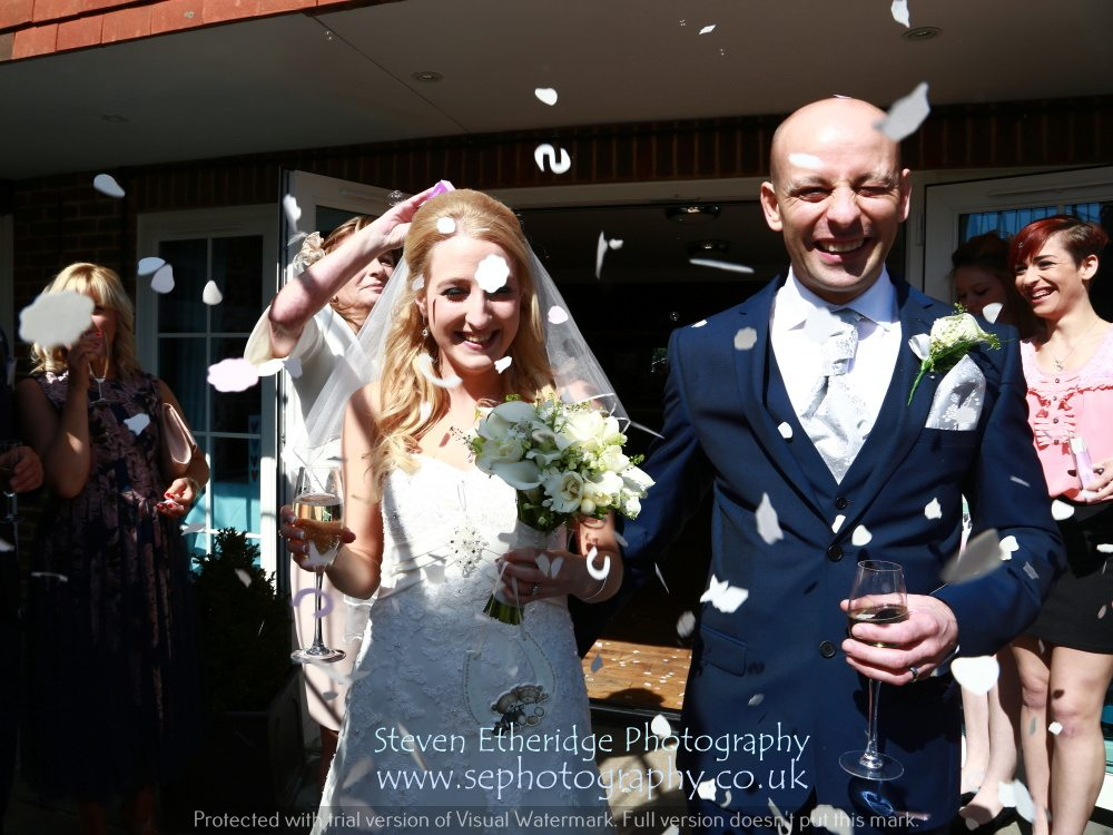 Hampshire Wedding Photography - bride and groom with confetti