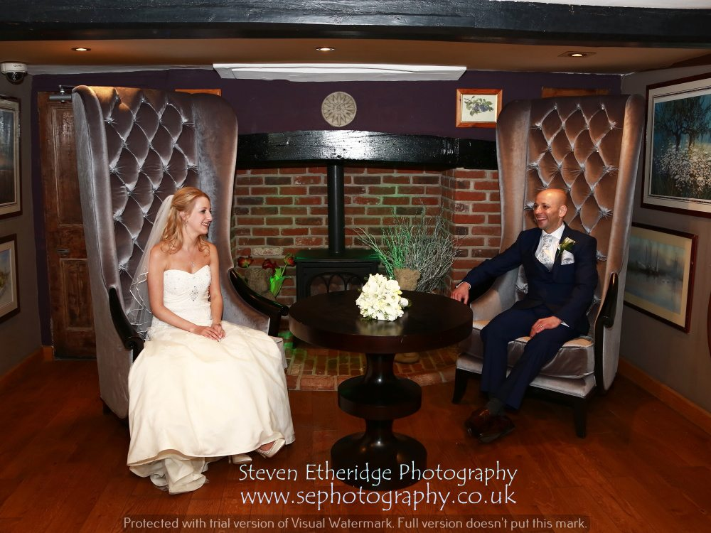 Hampshire Wedding Photography - bride and groom on thrones
