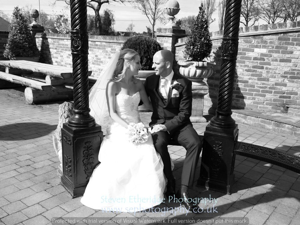 Hampshire Wedding Photography - bride and groom talking on terrace