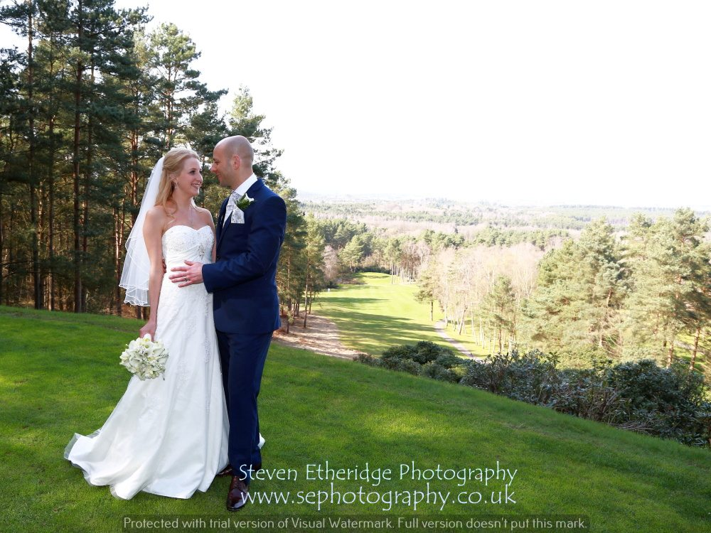 Hampshire Wedding Photography - bride and groom with view from top tee