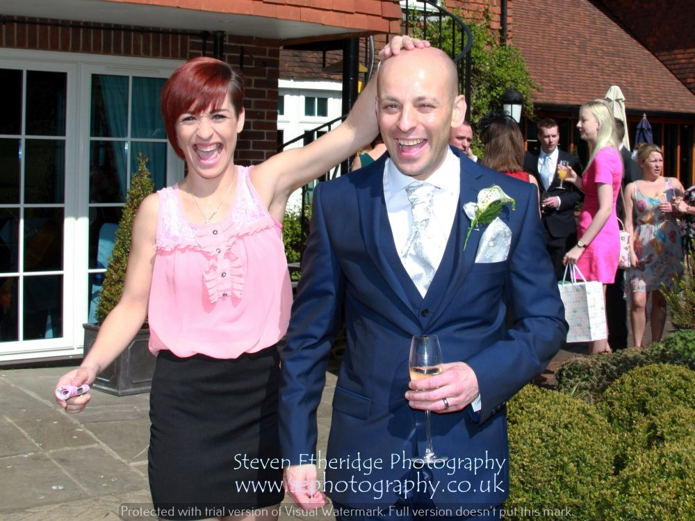 Hampshire Wedding Photography - groom and friend laughing