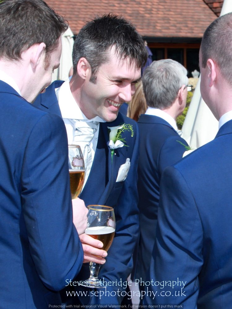 Hampshire Wedding Photography - best man laughing with his friends