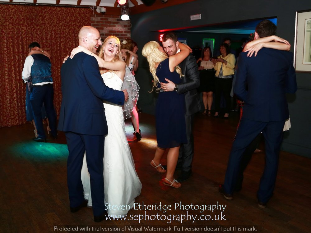 Hampshire Wedding Photography - bride and groom on the dancefloor with their guests