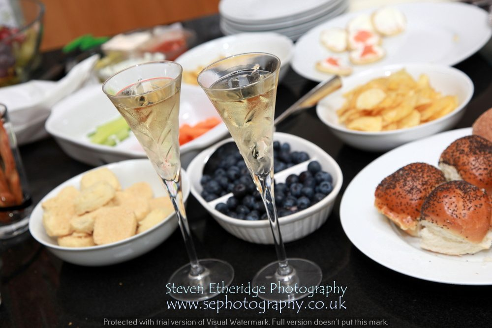 Surrey Wedding Photographer - champagne and buffet food for bridal preparations