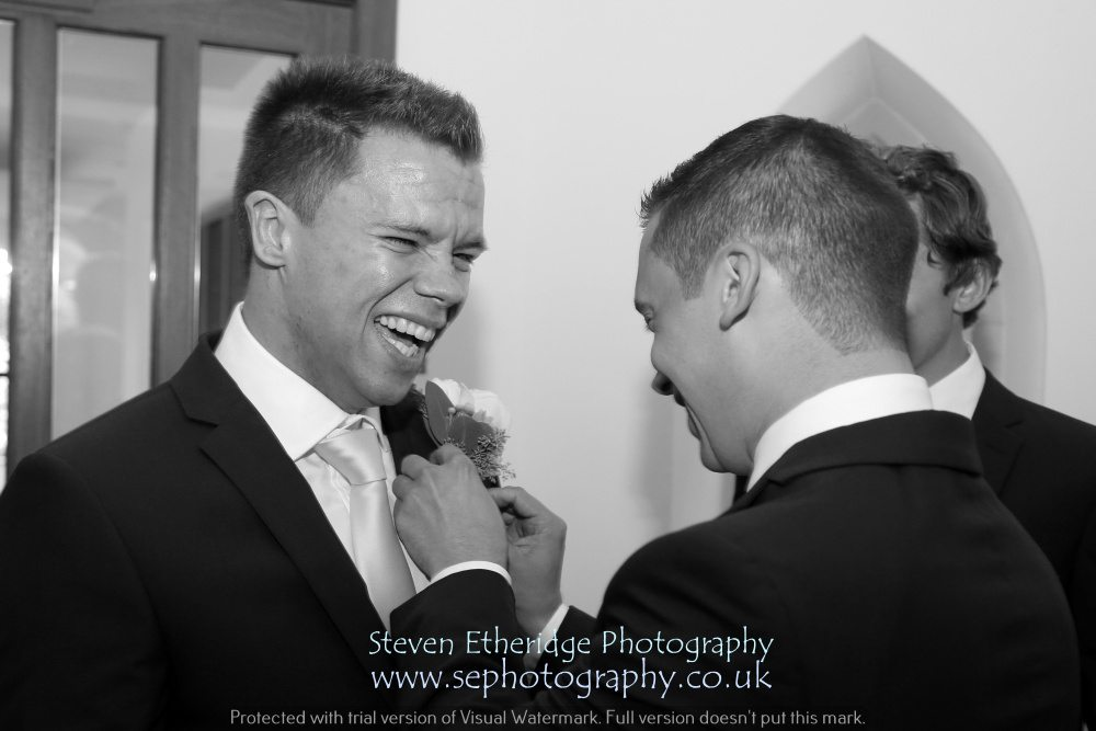 Surrey Wedding Photographer - groom and best man buttonholes