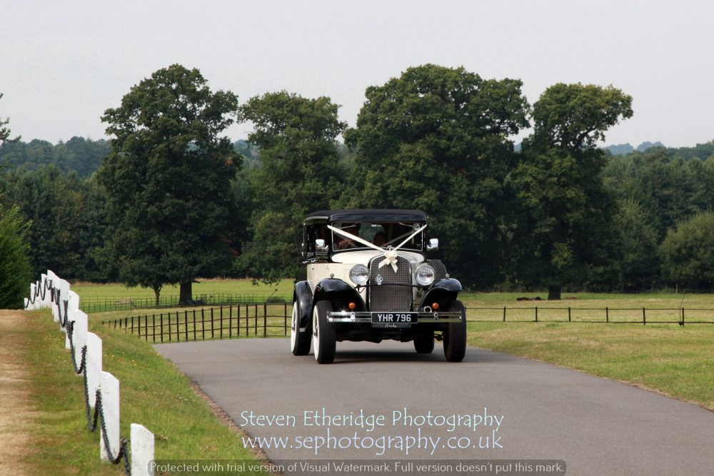Surrey Wedding Photographer - bride arriving at church vintage car