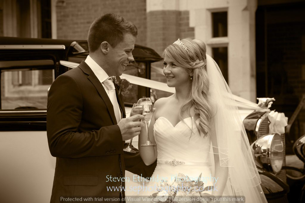 Surrey Wedding Photographer - bride and groom with vintage car