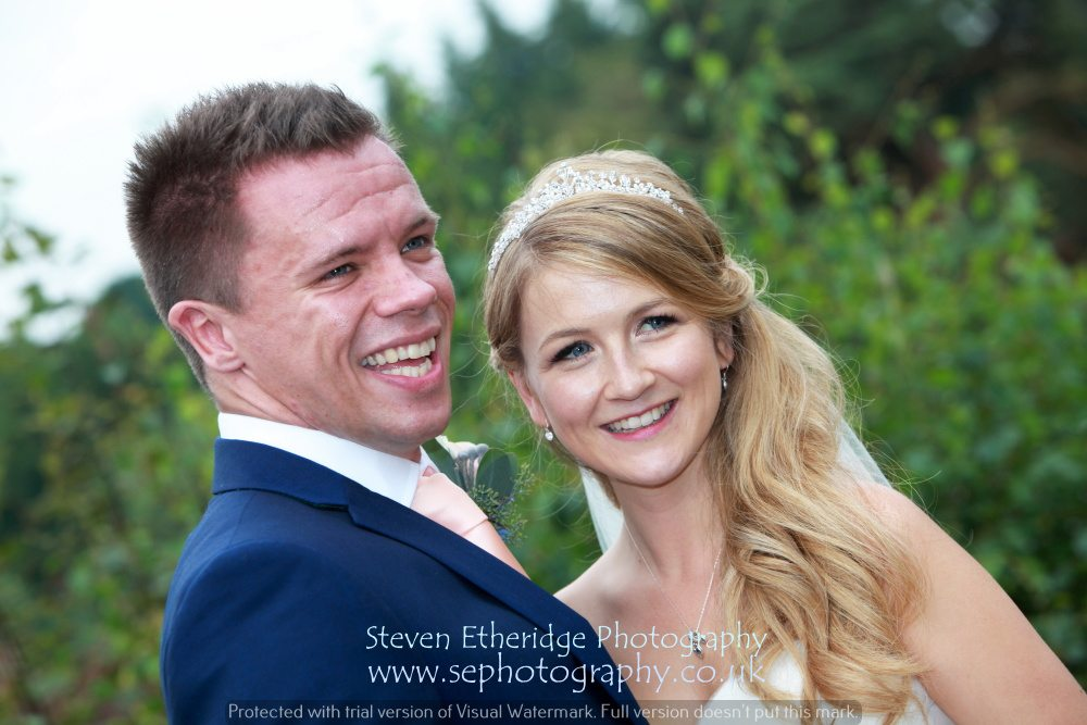 Surrey Wedding Photographer - bride and groom posing