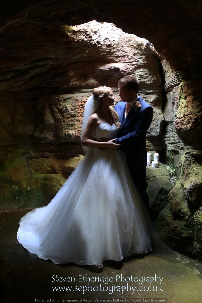 Surrey Wedding Photographer - bride and groom in Wotton House grotto