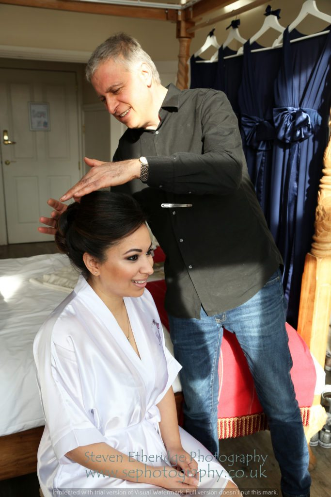 Hampshire Wedding Photographer - bride getting her hair done