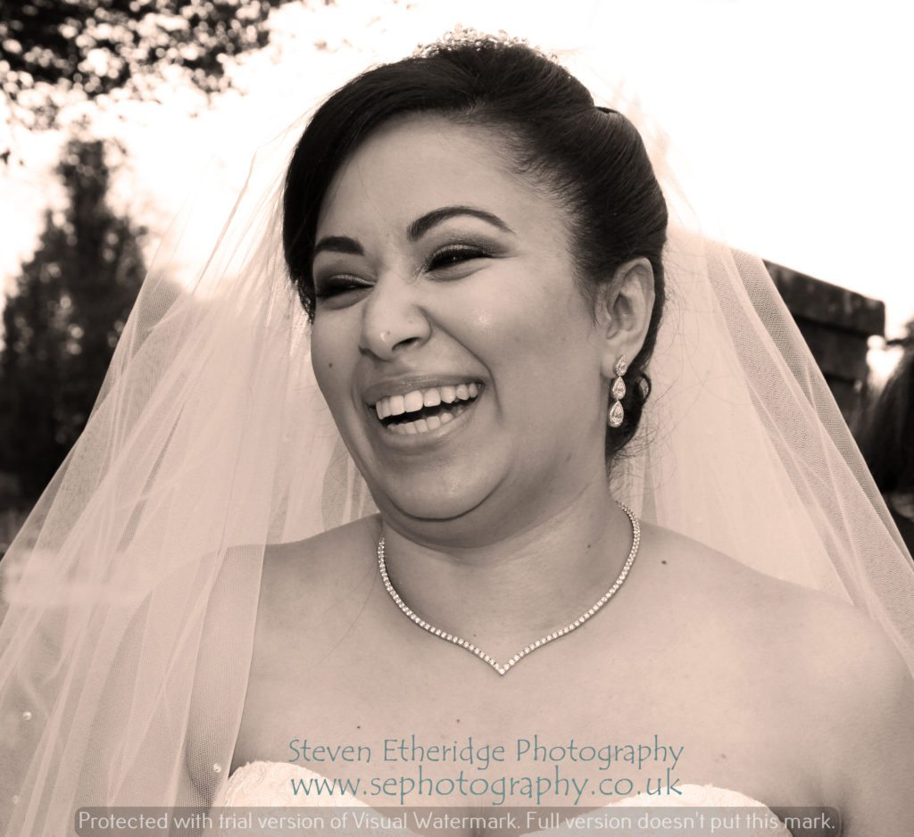 Hampshire Wedding Photographer - bride laughing