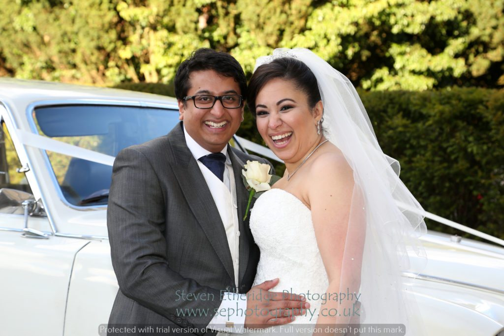 Hampshire Wedding Photographer - bride and groom with wedding car