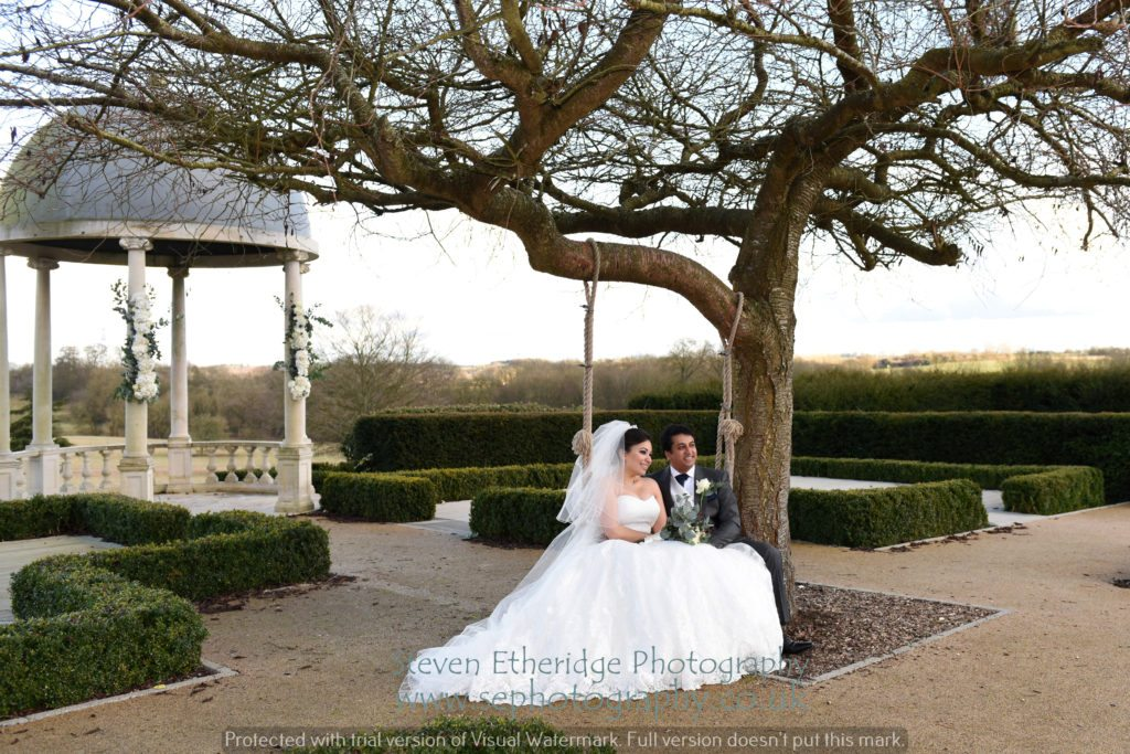 Hampshire Wedding Photographer - bride and groom on Froyle Park swing seat