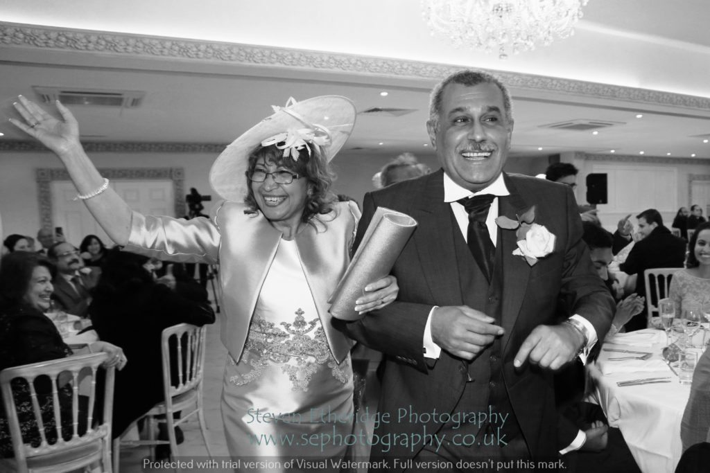 Hampshire Wedding Photographer - bride's parents making an entrance!