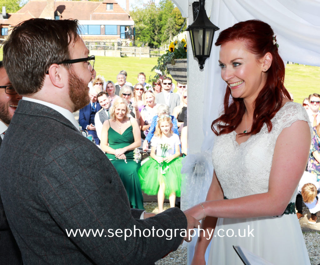 Surrey Wedding Photographer - bride and groom making their vows