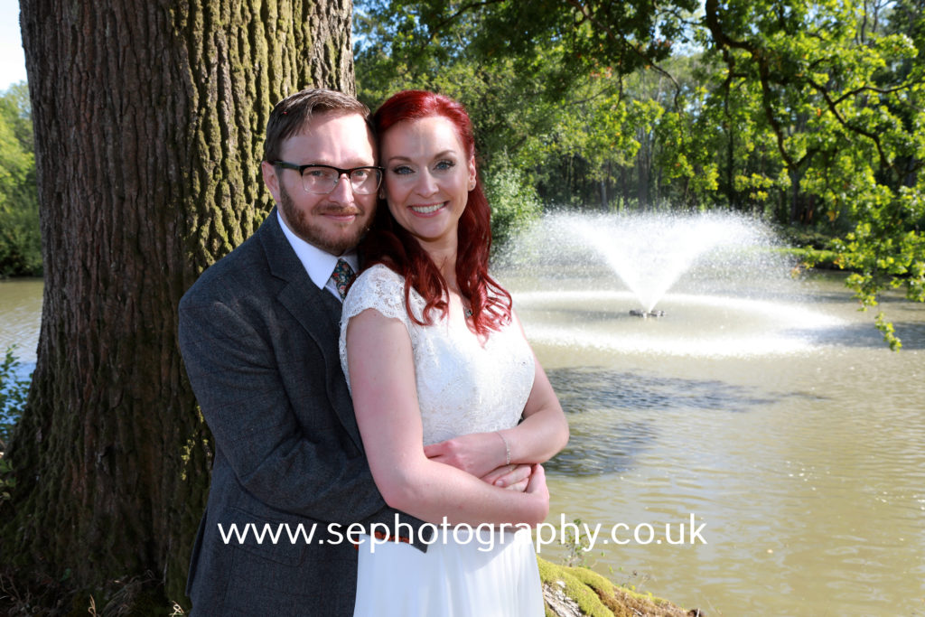 Surrey Wedding Photographer - bride and groom by fountain