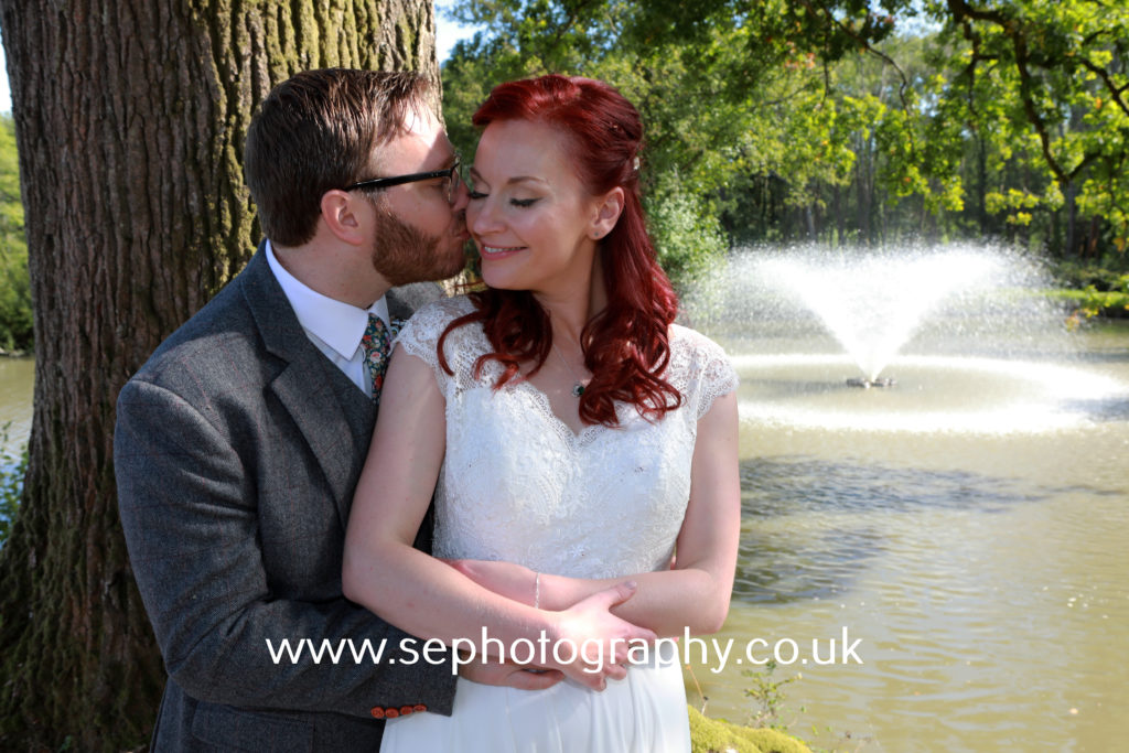 Surrey Wedding Photographer - bride and groom kiss
