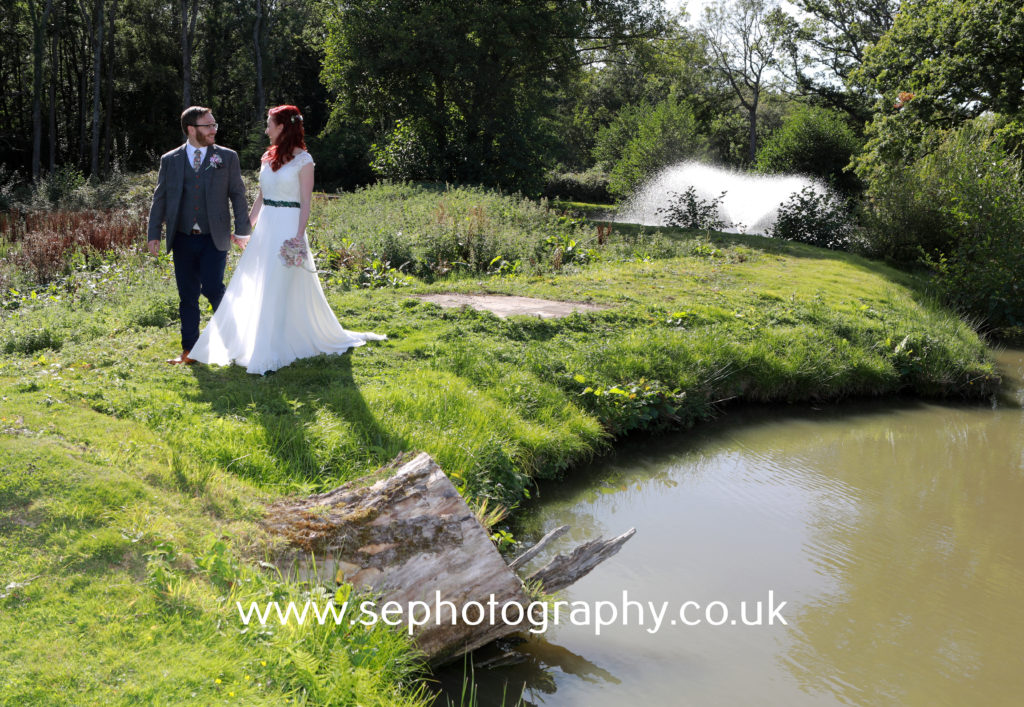 Surrey Wedding Photographer - bride and groom romantic walk